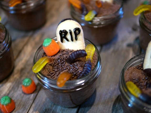Mason Jar Graveyard Spooky Cakes - Mason Jar Graveyard Spooky Cakes are little chocolate cakes that are baked in jar s and decorated to look like cute but creepy graveyards for Halloween!
