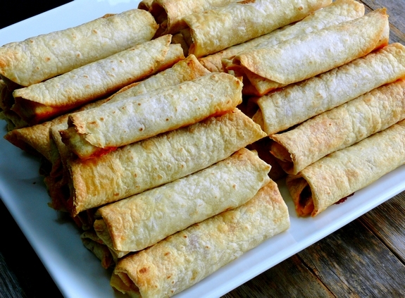 Oven Baked Pulled Pork Flautas stacks