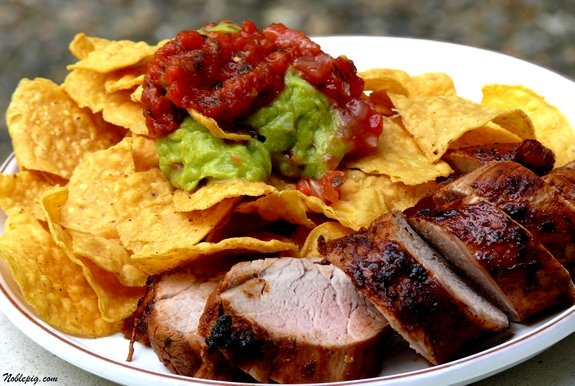 Chili-lime pork tenderloin with corn chips, guacamole and salsa.