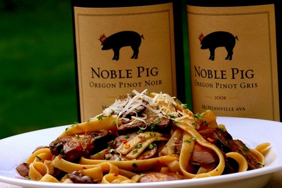 Mushroom fettucine with Noble Pig Pinot Noir wine in the background.