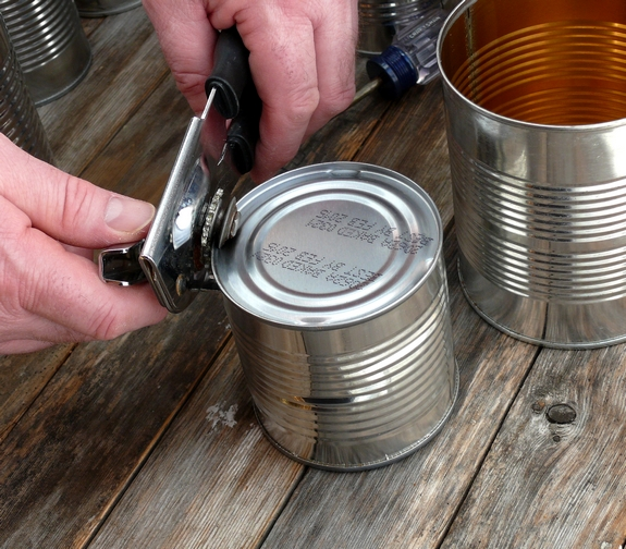 Easy DIY Flower Pot Centerpieces making holes with can opener
