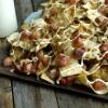 Sauerkraut and Kielbasa Nachos with Cracked Pepper-Dijon Cream