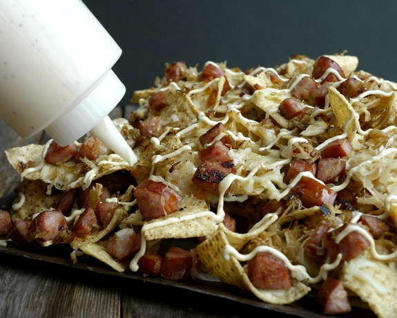 Sauerkraut and Kielbasa Nachos with Cracked Pepper Dijon Cream