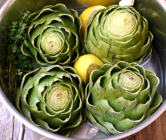 Steamed Artichokes with Garlic Orange Basil Cream Dipping Sauce steaming