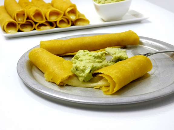 Smokey Soft Taco Roll Ups with Avocado Garlic Dipping Sauce melty yummy cheese