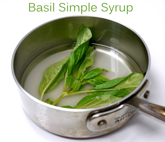 Basil Simple Syrup in text with basil leaves floating in a pan.