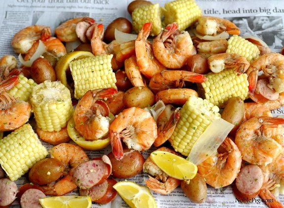 Low Country Shrimp Boil on a sheet of newspaper.