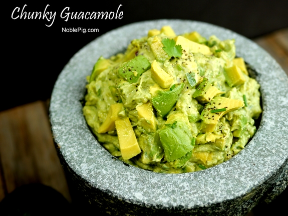 Chunky Guacamole in a bowl with text that reads chunky guacamole.