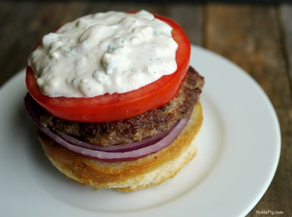 The Juciest Mediterranean Style Burgers with Creamy Feta Curry Dressing open face.