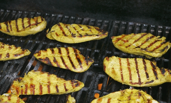 Grilled Turmeric Lemon and Lime Chicken on the grill
