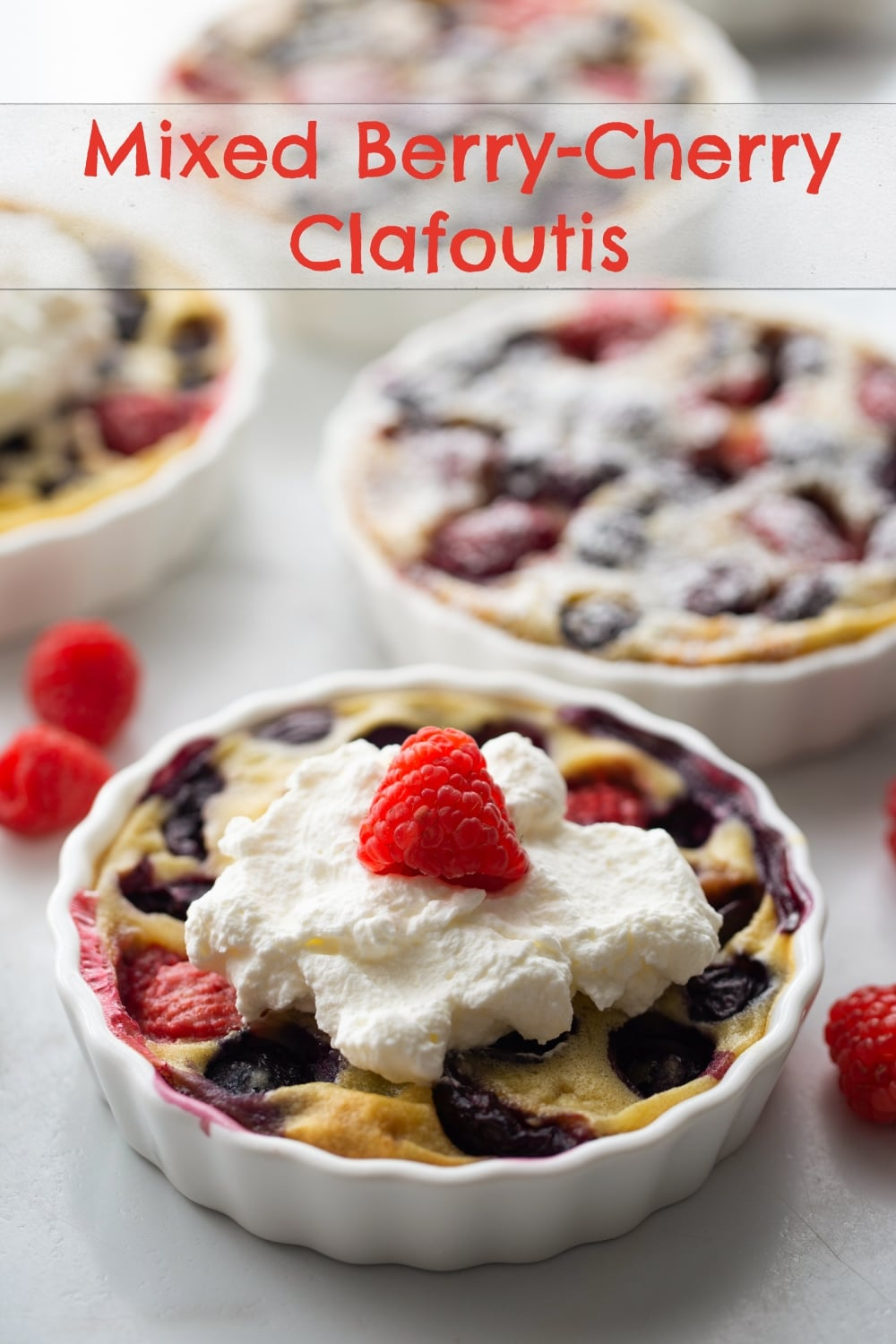 """Clafoutis is a traditional, rustic, custard-like, French dessert that uniquely """"shows off"""" summer fruit in the most delicious way possible. And it couldn't be easier to make! This particular version is packed with fresh cherries, raspberries and blueberries, all at their peak of ripeness. via @cmpollak1"""