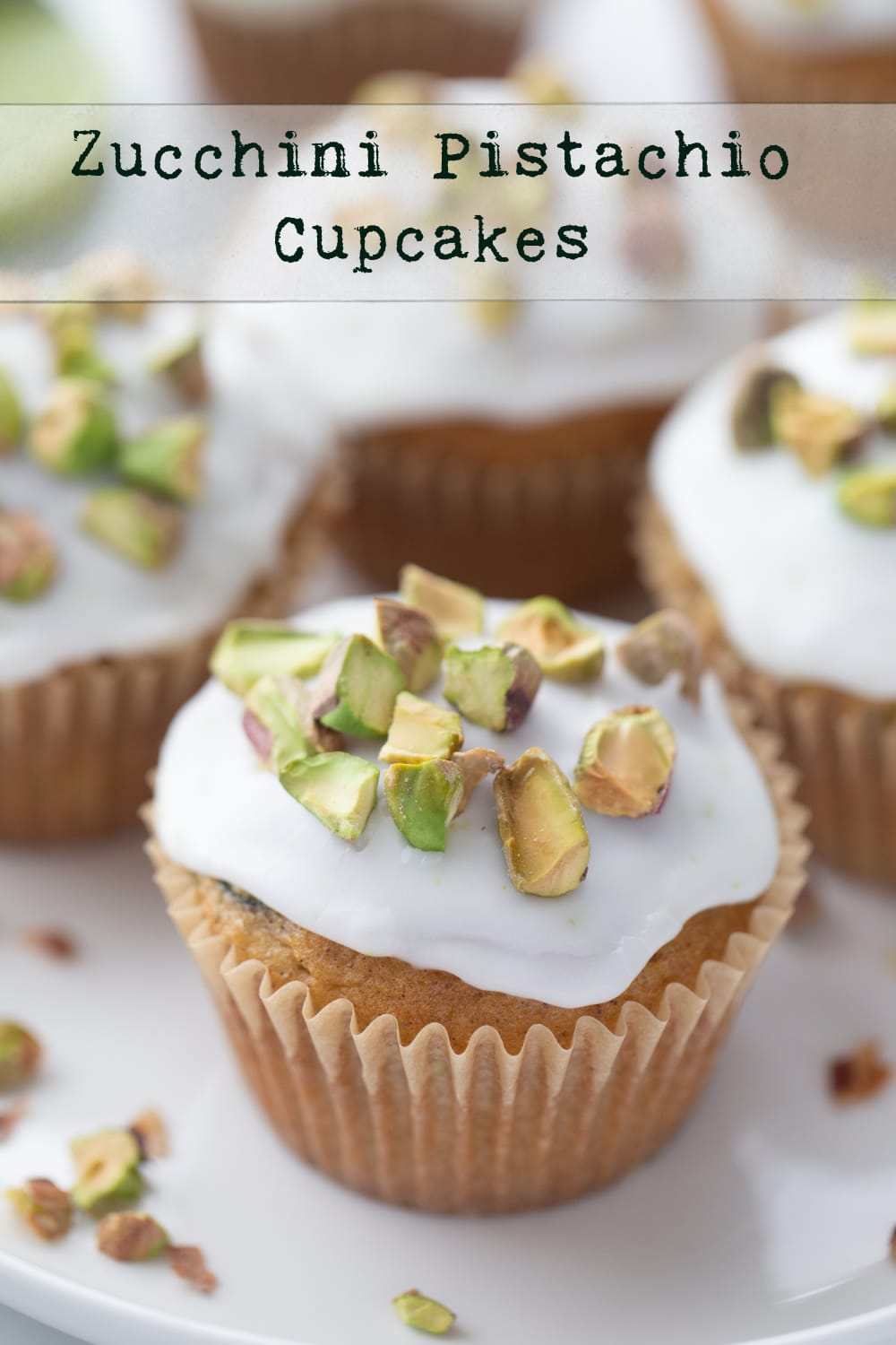 Zucchini Pistachio Cupcakes - an irresistible spiced dessert with a zingy lime icing and topped with crunchy pistachios. You'll actually forget you're eating your veggies too. via @cmpollak1