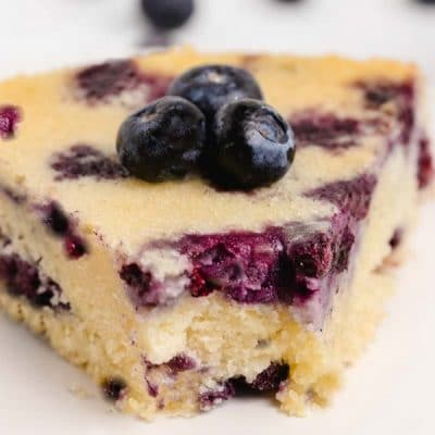 Stuffed with plump blueberries, this Loaded Blueberry Coffee Cake is soft, sweet and topped with turbinado sugar for a crunchy crust. The perfect tender cake for breakfast or brunch. #blueberry #blueberrycoffeecake #coffeecake #easterbrunch #brunchrecipe #easybrunchrecipes #blueberries