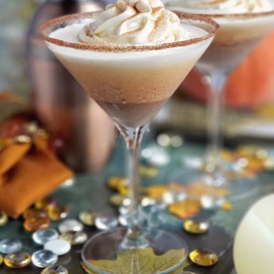Pumpkin pie martinis on a tray.
