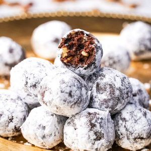 Sophisticated and elegant, these Zinfandel Port Balls are a festive dessert for any occasion. The port and cocoa meld together, erupting into a smooth and warming flavor, sans any raw alcohol taste. Perfect for gifting too. #noblepig #port #portwine #zinfandel #zinfandeldessert #dessert #dessertballs #cocoa #homemadegifting #homemadegift #ediblegift #winedessert #dessertwine #holidaygift #valentinesdessert #newyearseve #christmasdessert