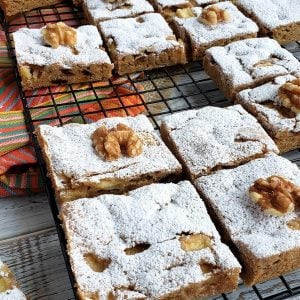 Fresh apple spice bars on a cooling rack.