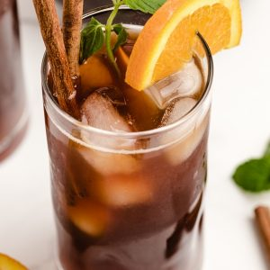 Iced tea in a glass with orange slice