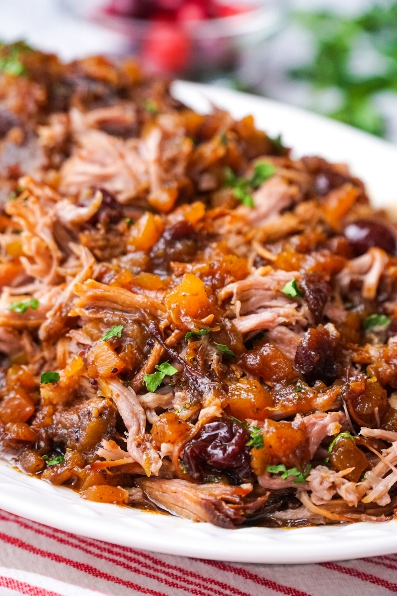 Take the work out of making dinner with this savory and slightly sweet Slow Cooker Pork with Cranberry-Pineapple Sauce. Only five minutes of prep time are needed for this delicious recipe. #slowcooker #slowcookermeal #pork #slowcookerpork #cranberry #pineapple #easyslowcookerrecipe #easyslowcookerrecipes #easydinners #whatsfordinner #dinnerideas #whatshouldimakefordinner #porkroast #pulledpork #cozydinner #whatshouldieat