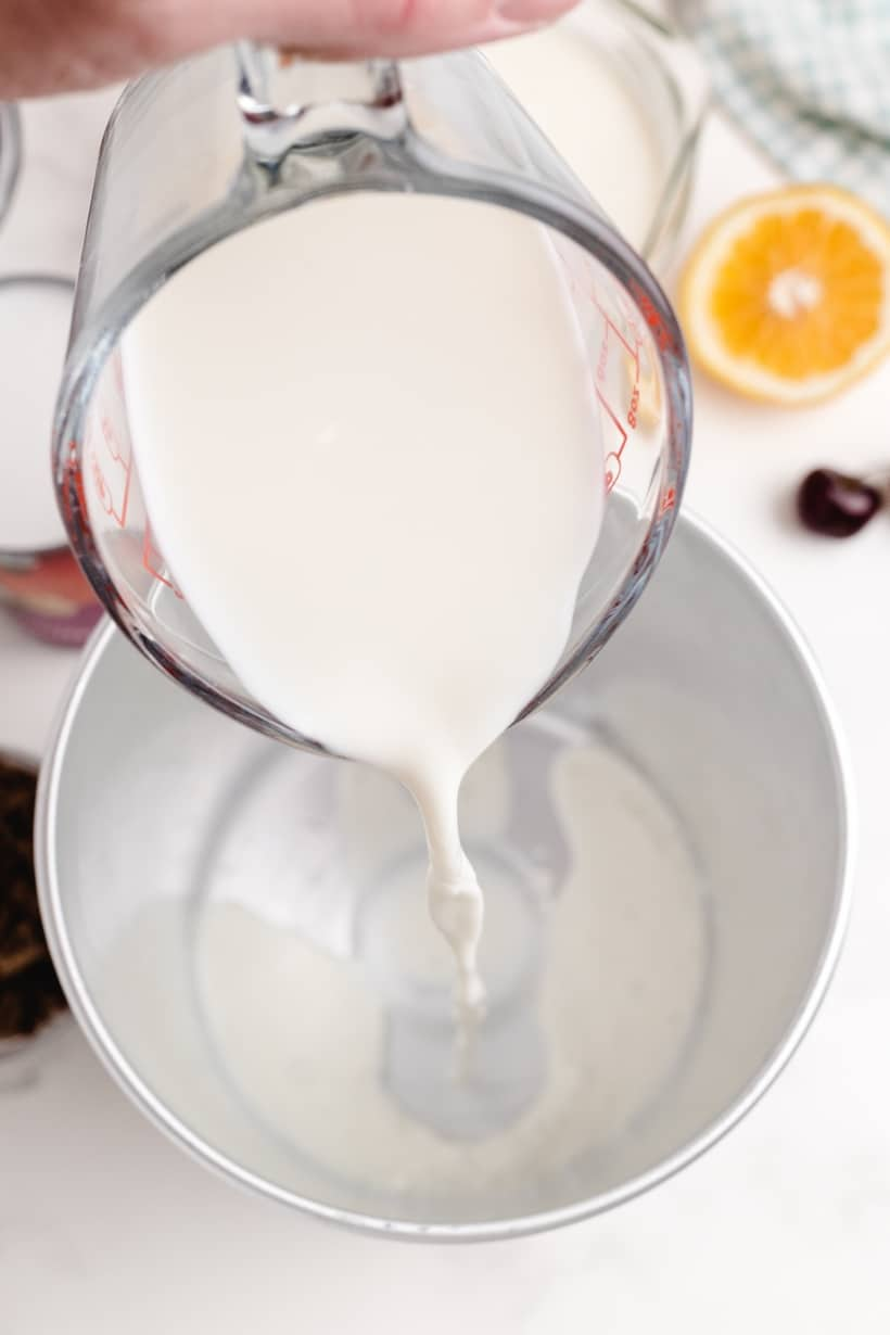 Milk being poured into a vessel.