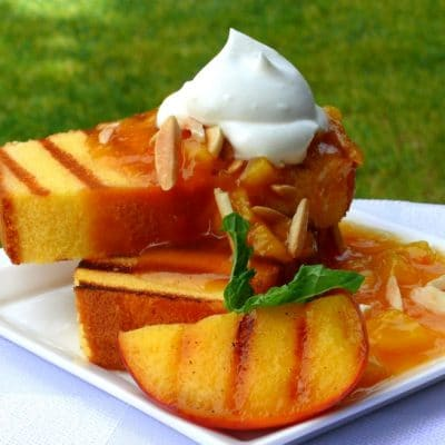 Grilled pound cake with grilled peaches and chantilly cream.