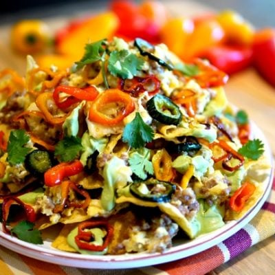 Kicked Up Breakfast Nachos with Fluffy Eggs, Avocado Cream & Roasted Peppers