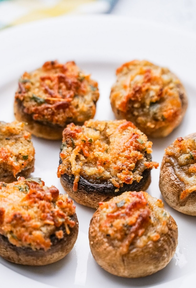 These Italian Stuffed Mushrooms are the perfect party appetizer for any occasion. Put these stuffed mushrooms together early in the day and bake them off right before guests arrive. #noblepig #mushrooms #italianstuffedmushrooms #partyappetizer #partyappetizerforacrowd #mushrromappetizer #stuffedmushrooms #italianfood #italianappetizer #partyfood