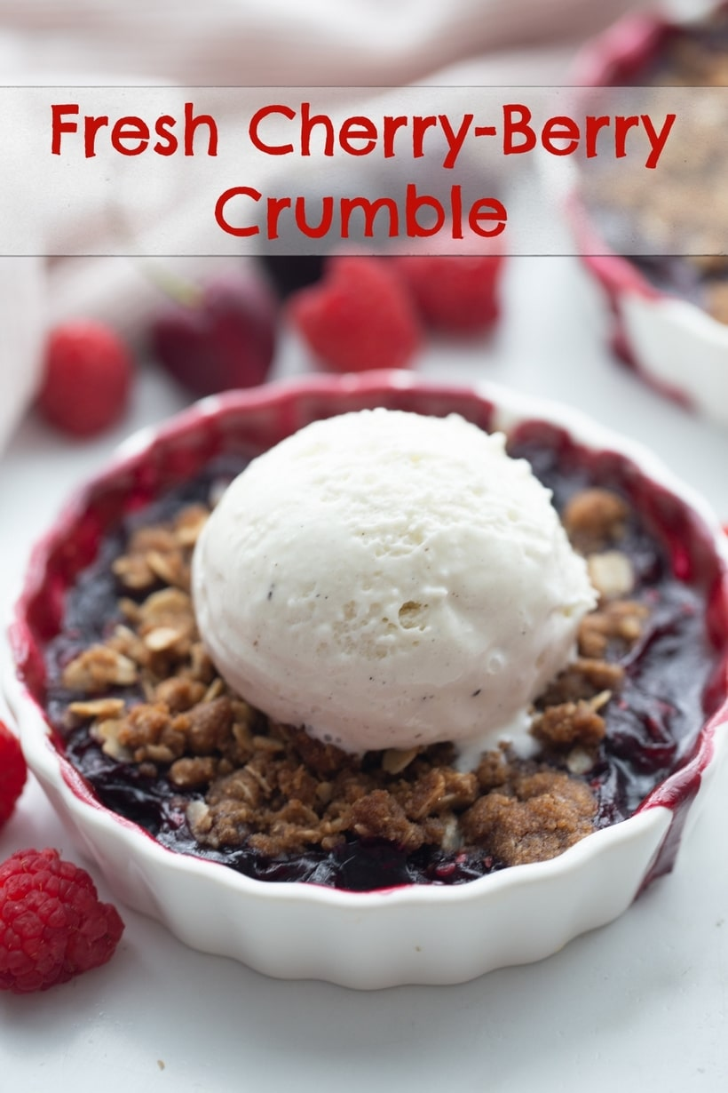 Cherry-Berry Crumble – a fresh cherry and raspberry filling covered with the most spectacular, crumbly topping you won't be able to resist. One of the best fresh cherry desserts! via @cmpollak1