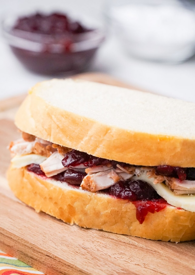 Leftover turkey becomes next-level deliciousness with these Leftover Turkey-Cranberry Monte Cristo Sandwiches. You almost can't wait to get up the next day and make them! #leftoverturkey #noblepig #leftoverturkeyrecipe #montecristo #montecristosandwich #leftovercranberrysauce #cranberry #cranberries #easyleftoverturkeyrecipe #thanksgivingleftovers