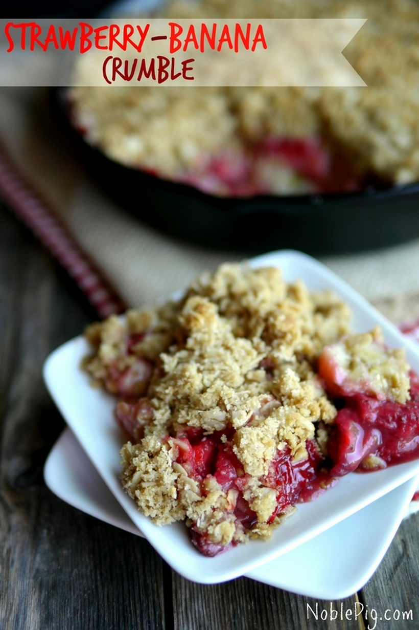 Strawberry-Banana Crumble in text with a serving of the crumble on a white plate.