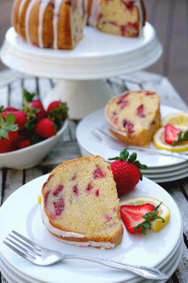 VIDEO + RECIPE: This from scratch Strawberry Lemon Cream Cheese Pound Cake is a deliciously rich cake that is not overly sweet. I've incorporated cream cheese, which is unusual for pound cake. The cream cheese gives the cake a springy crumb texture, richness and tenderness, while keeping the cake moist for several days. It is the perfect choice for strawberry season and beyond from NoblePig.com. #noblepig #poundcake #strawberrycake #cake #lemoncake via @cmpollak1