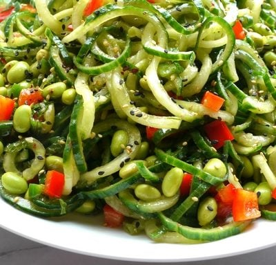 Cucumber Edamame Salad with Ginger-Soy Vinaigrette in a bowl.