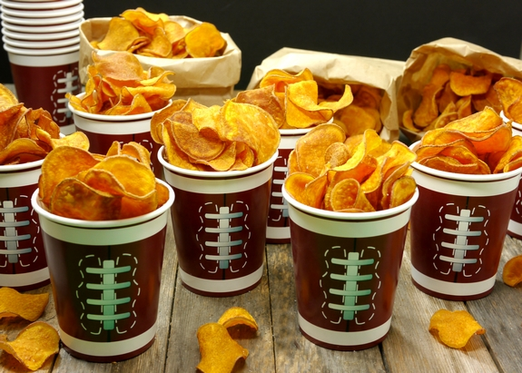 The Best Homemade Sweet Potato Chips filled lots of cups that look like footballs.