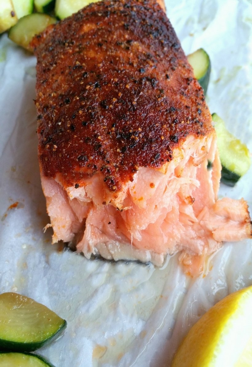 One piece of cooked salmon that has been flaked to see the inside of the fish.