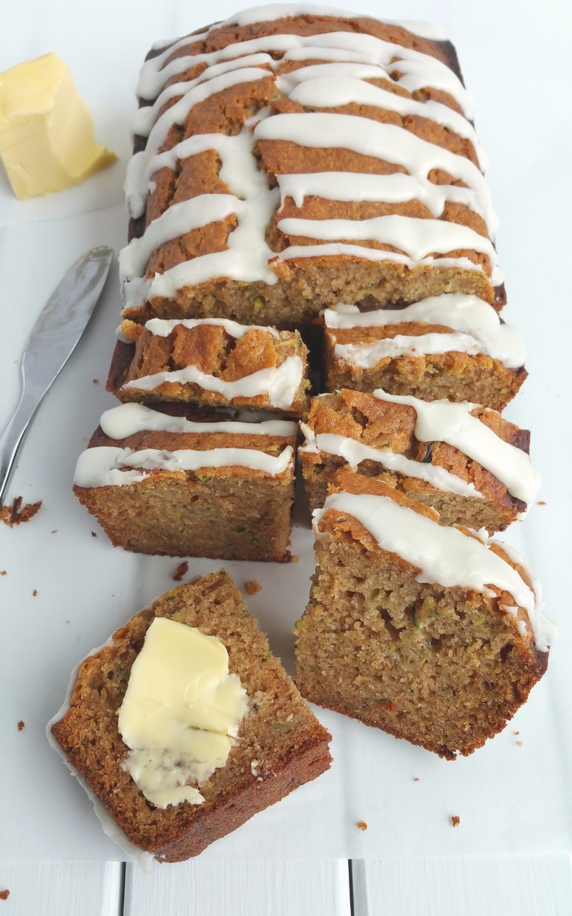 A slice of this Zucchini Honey Loaf  is all you need in the afternoon to get you through the afternoon slump.  It's definitely the right choice with a cup of coffee or tea from NoblePig.com. #noblepig #snackcake #honey #zucchinibread #zucchini