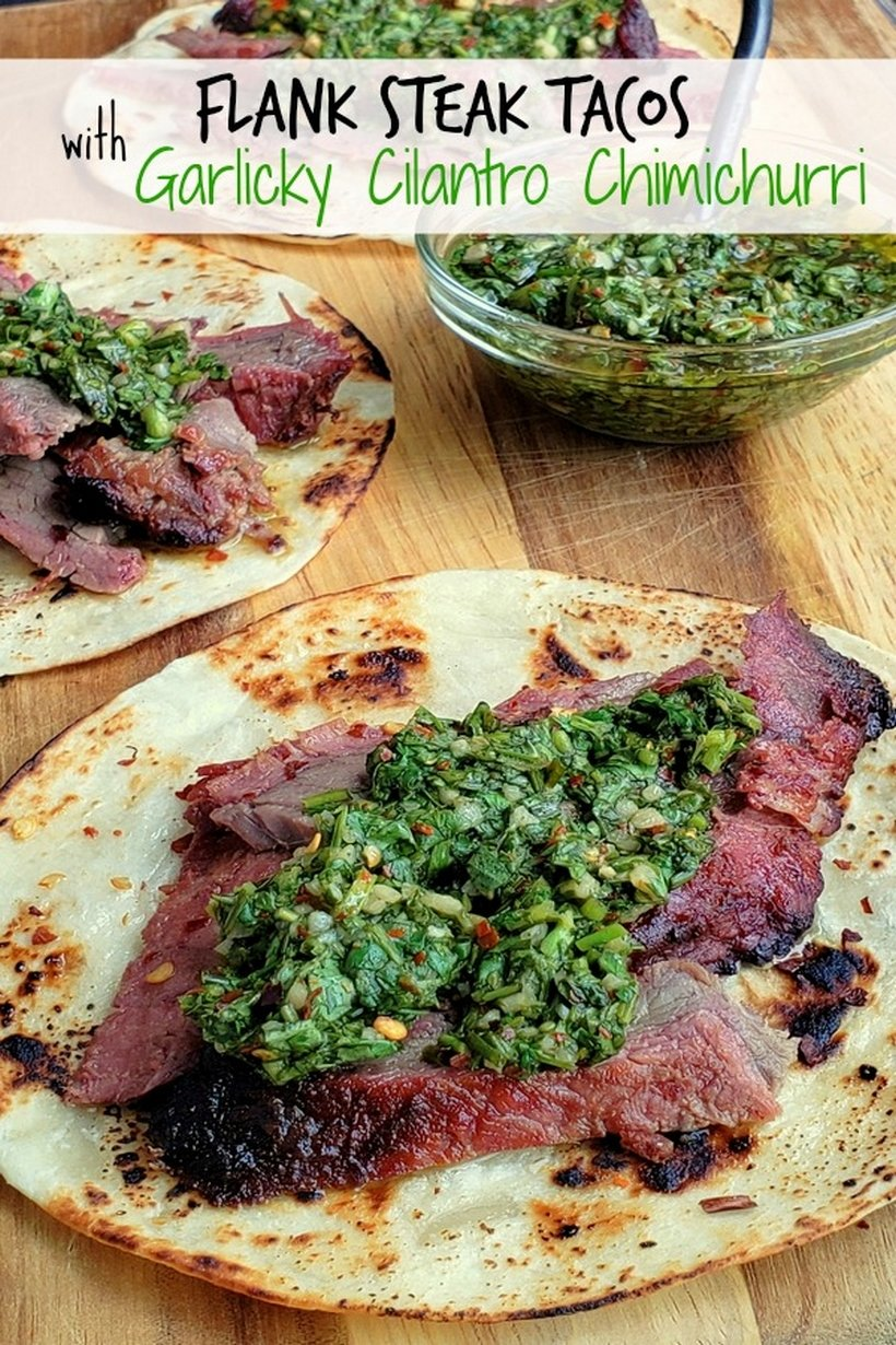 Text on photo reads Flank Steak Tacos with Garlicky Cilantro Chimichurri, with three tacos present and bowl of chimichurri.