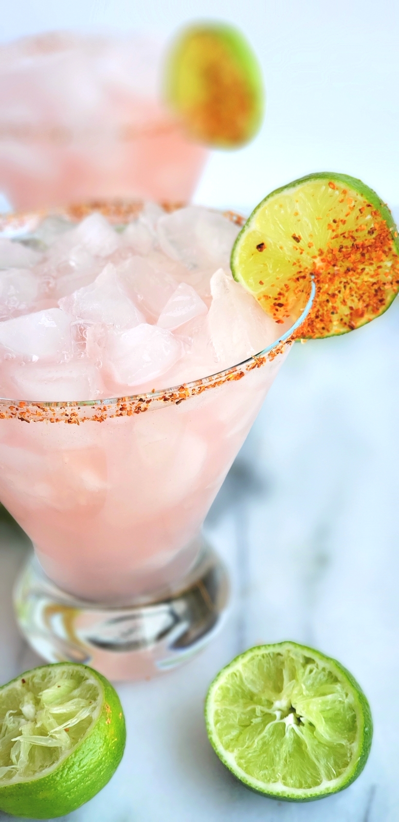 The petal pink color of this Icy #Hibiscus #Margarita is alluring, but it's the sweet, tangy and refreshing flavor that will have you asking for a second pour. #cocktail #noblepig