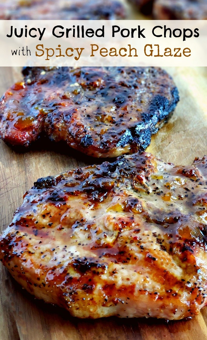 Pork chops a wooden board with text that reads juicy grilled pork chops with spicy peach glaze
