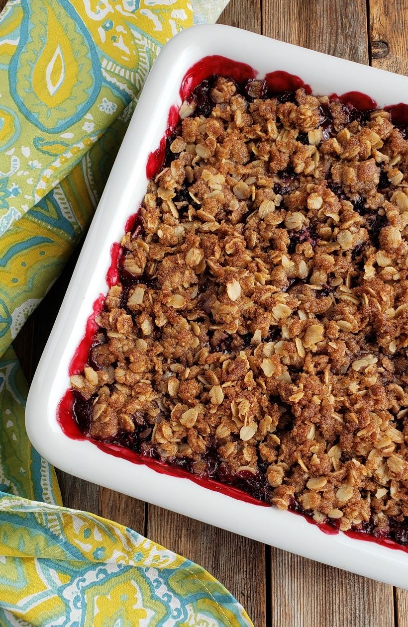 Baked blackberry crumble in a serving dish.