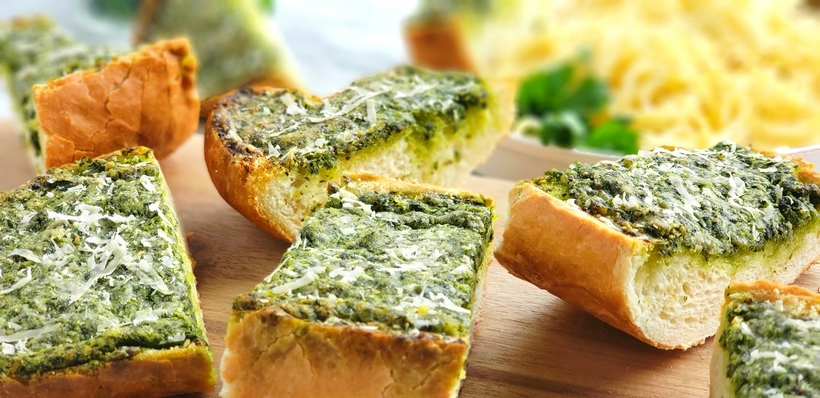 Use up your  leftover parsley with this deliciously, flavorful Garlicky, Cheesy Parsley Bread. It's the perfect side dish for a bowl of pasta. #noblepig #parsley #garlicbread