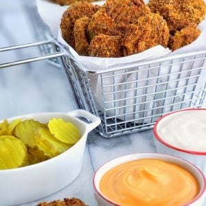 Whip up these Low Carb Air Fryer Pickles in minutes. The perfect guiltless snack for any gathering.