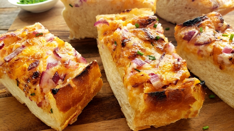 Cheesy Bread Spread will transform your regular loaf of bread into a mouthwatering sensation. Serve this bread with pasta dishes or next to a freshly made salad. #cheesybread