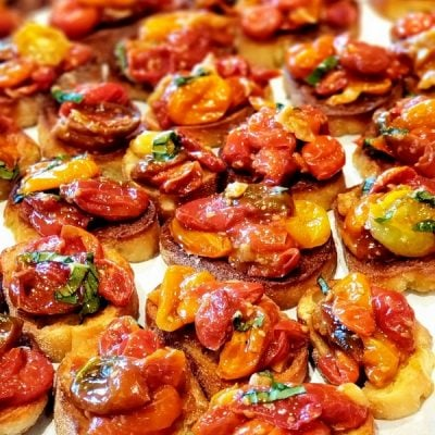 Roasted Garlic Bruschetta on parchment paper.