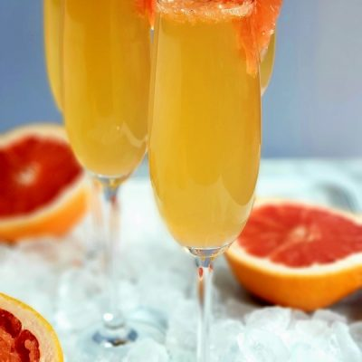 Grapefruit Prosecco Cocktails on a tray with ice.