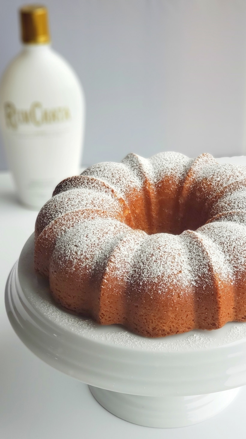 RumChata Bundt Cake on a white cake stand.