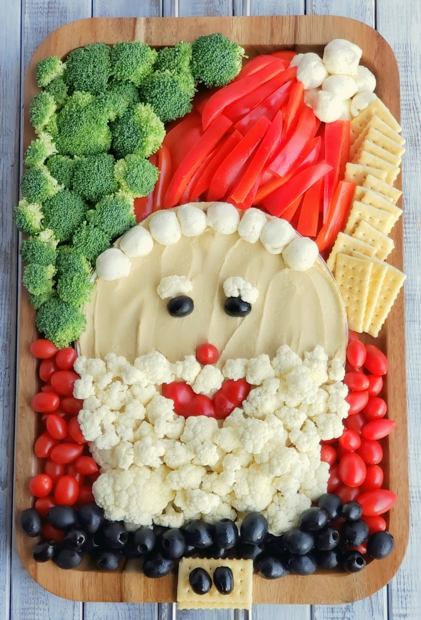 This Santa Snack Board is the perfect holiday centerpiece for every gathering this season. Not only is this healthy snack board festive and fun, it uses simple ingredients everyone loves. This Santa Board transports easily, feel free to take it along to every celebration this season. #noblepig #santasnackboard #diysantasnackboard #diy #healthysnackboard #christmas #christmasrecipes #easychristmasrecipes #holidayrecipes #santafood #santa #holidayentertaining #holidayfood #christmasappetizer