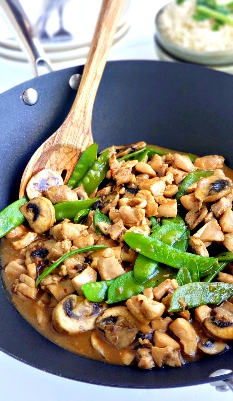 Chicken and snow pea stir-fry in a wok.
