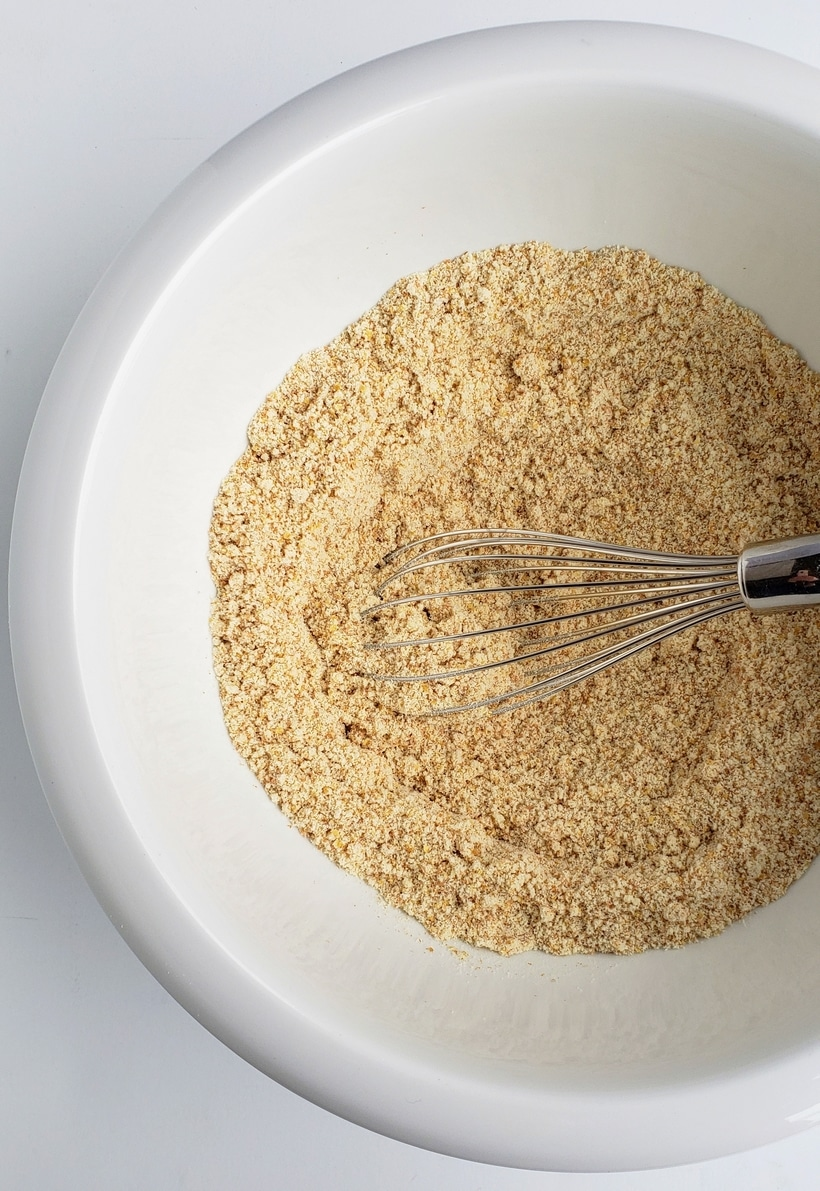 All flours in a bowl with a whisk.