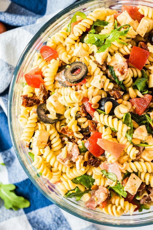 Big bowl of colorful Italian pasta salad.