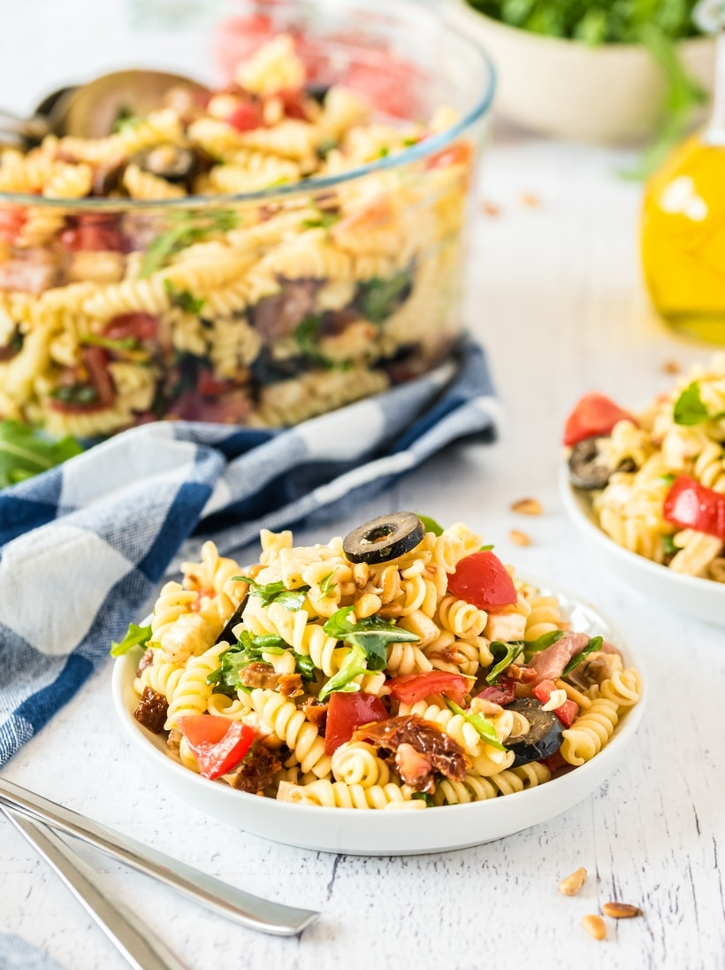 Several bowls of Italian pasta salad.