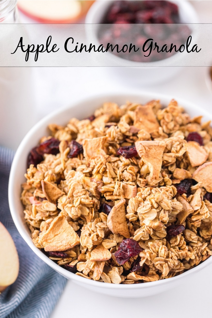 Apple Cinnamon Granola, you'll never buy store-bought granola again! This baked granola is perfect for breakfast or snacking by the handful. via @cmpollak1